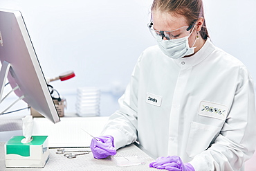 Female technician working with tests