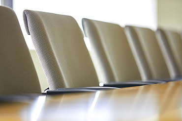 Office chairs in row at table