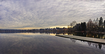 USA, Washington, Seattle, Pier at lake at sunset