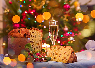 Panettone and glass of white wine on Christmas table