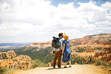 USA, Utah, Bryce Canyon, Couple holding hands and kissing against canyon - 1178-29746
