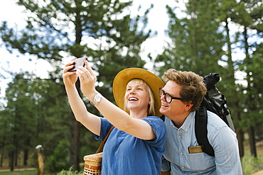 USA, Utah, Bryce Canyon, Couple taking selfie in national park