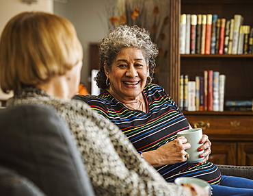 Senior women drinking tea and talking