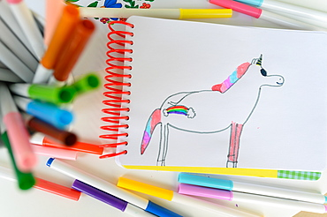 Child's drawing on unicorn with rainbow