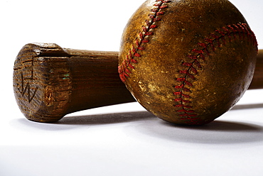Studio shot of old baseball bat and ball