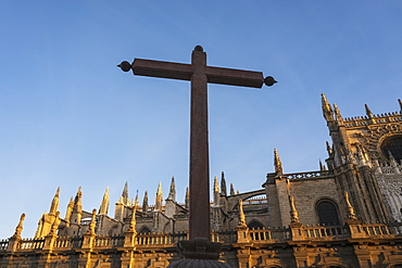 Spain, Seville, Cross against facade of Seville Cathedral