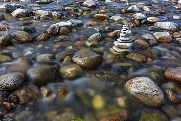 USA, Idaho, Sun Valley, Rock stack among river rocks