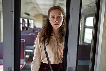 Russia, Novosibirsk, Portrait of young woman in train