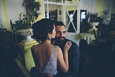 Romantic couple embracing on date in restaurant