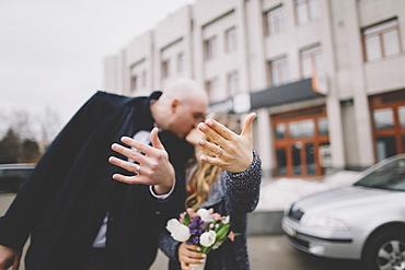 Newlywed couple kissing on street - 1178-29934