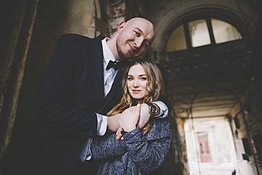 Portrait of smiling newlywed couple