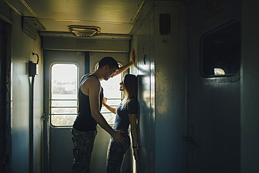 Young couple flirting in train