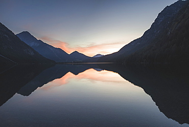 Austria, Plansee, Lake Heiterwanger in Austrian Alps in sunrise