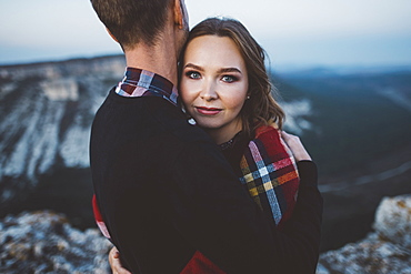 Ukraine, Crimea, Young couple hugging near canyon
