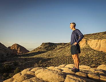 USA, Utah, St. George, Man standing in rocky landscape