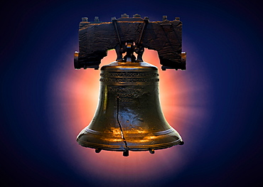 Liberty bell against blue