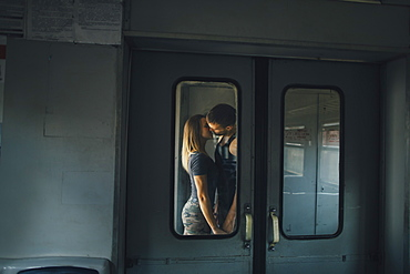 Couple kissing on train