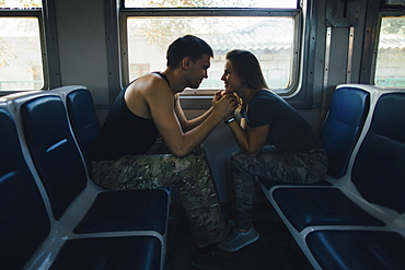 Romantic couple on train