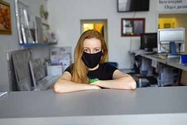 Portrait of woman wearing flu mask in office
