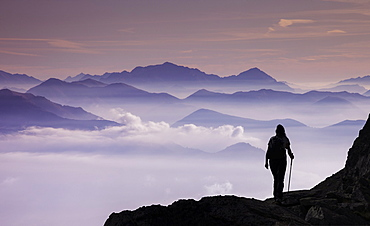 Italy, Piedmont, Alps, Monte Rosa, Silhouette of female climber on mountain ridge