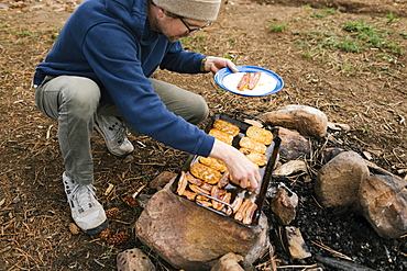 Man cooking breakfast during camping