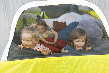 Girls (2-3, 6-7) in tent