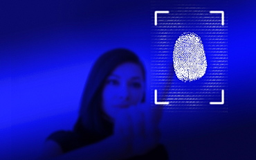Woman leaving her fingerprint on screen