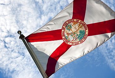USA, Florida, State flag of Florida against cloudy sky