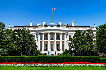 USA, Washington D.C., White house with green grass and summer sky