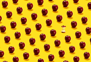 Large group of red apples on yellow background