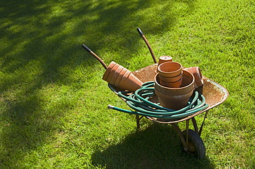Still life of wheelbarrow and gardening tools
