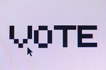 Computer monitor displaying the word vote