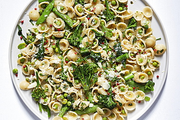Orecchiette with broccoli and peas on plate