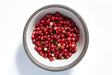 Red peppercorns in bowl
