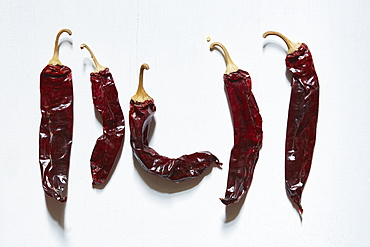 Dried chilli peppers on white background