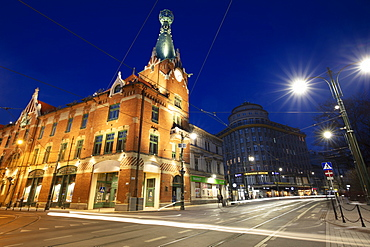 Poland, Lesser Poland, Krakow, Illuminated street and buildings in historic city district