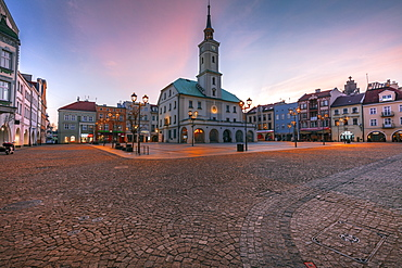Poland, Silesia, Gliwice, Historic town square with town hall at dusk