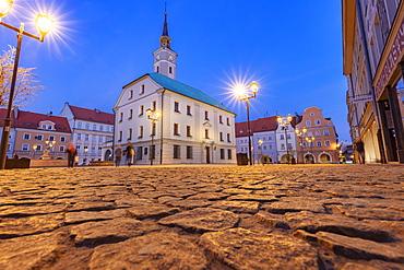 Poland, Silesia, Gliwice, Illuminated town square with cobblestone