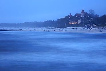 Poland, Pomerania, Leba, Castle at Baltic Sea coast at dusk