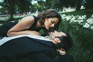 Ukraine, Couple embracing in garden
