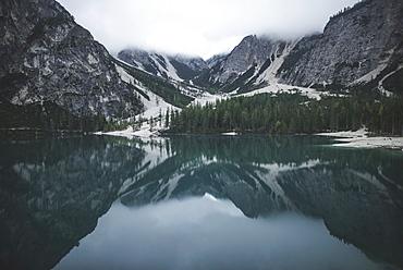 Italy, Pragser Wildsee, Dolomites, South Tyrol, Mountain range reflecting in lake