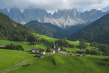 Italy, South Tyrol, Funes, Santa Magdalena, Landscape with village in valley