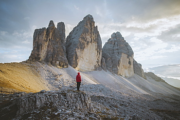 Italy, South Tirol, Sexten Dolomites, Tre Cime di Lavaredo, Man looking at rock formations