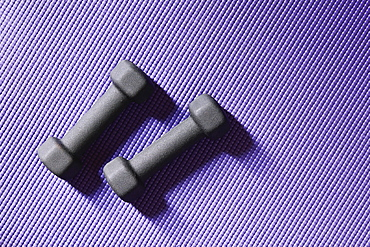 Close up of weights on yoga mat