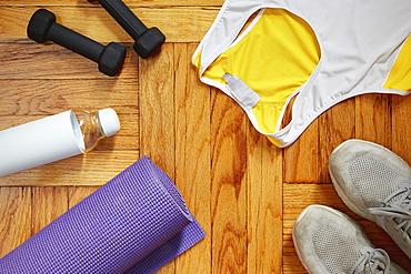 Sportswear and equipment on floor