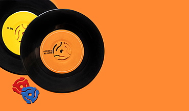 Vintage records on orange background