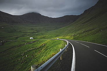 Denmark, Faroe Islands, Vagar, Sorvagur, Road through green landscape
