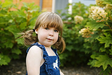Portrait of toddler girl (2-3) in garden