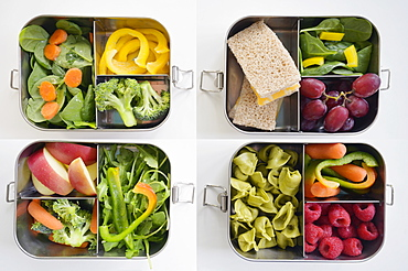 Lunch boxes with fresh vegetables and fruits