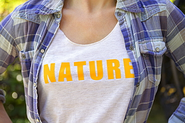 Midsection of girl (6-7) wearing nature t-shirt